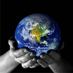 image of a globe in someone's hands