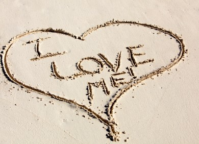 """I love myself"" written in the sand"