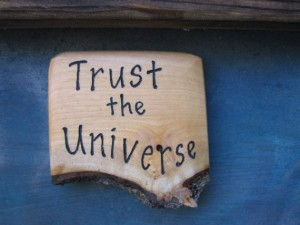 "a plaque saying ""trust the universe"""