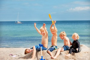 3 kids playing on the beach